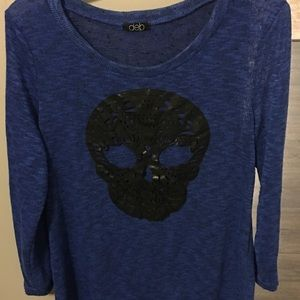 2X Sheer blue shirt with leather skull appliqué